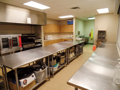 "<p style=""text-align: left;"">The full service kitchen in the Christian Life Center allows for  meals to be prepared and served. The area has a service window into the gymnasium.</p>"